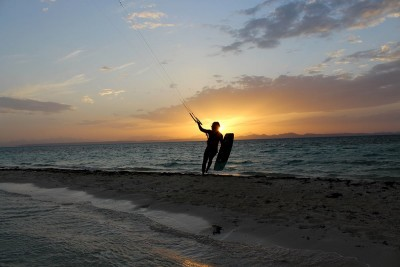 Picture from NKE's kite surfing safari Noveber 2018 - kiter returning to the beach at sunset